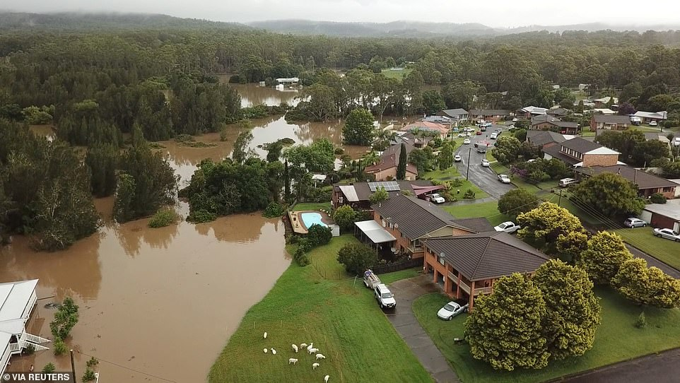 Houses are destroyed after flooding following heavy rainfall in Tinonee, New South Wales