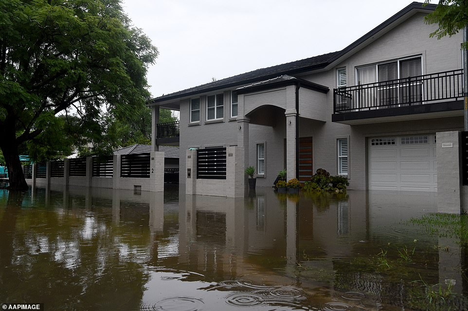 By 4.30pm on Sunday, floodwaters had started to inundate homes inu00A0Ladbury Avenue Penrith (pictured)