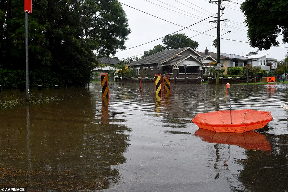 An abandoned umbrella lies at the flood intersection of Ladbury and Memorial Avenue in Penrith in Sydney's west