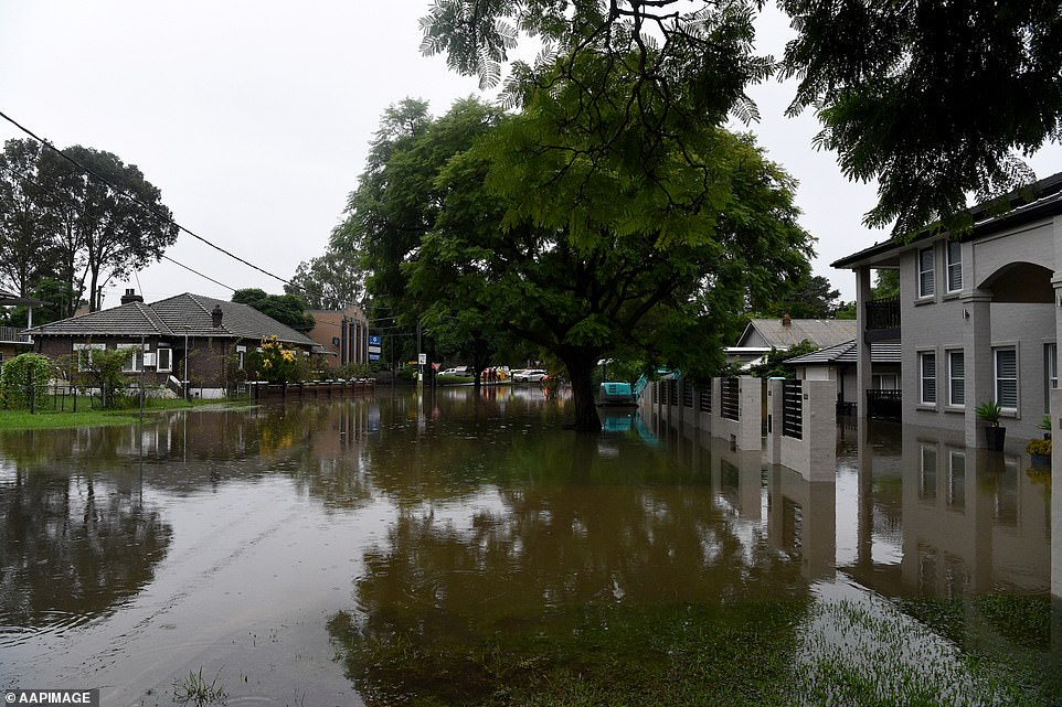Streets and front yards of houses were completely submerged by floodwater on the corner of Ladbury Ave in Penrith on Sunday