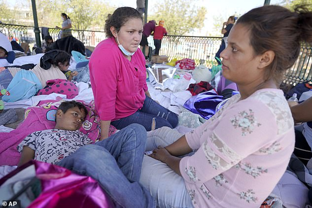 Blanca Lopez Carranza (center) a migrant from El Salvador, talks with Jeydy Oseguera (right) and her eight-year-old son, Justin Melendez Oseguera, after their expulsion from the US