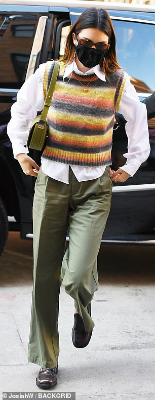 Pairing well: The fashion industry icon also wore a pair of pleated light green pants as she made her way through the city's bustling streets