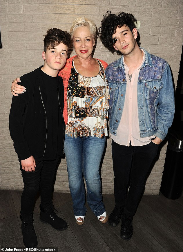 Reflective:u00A0Also reflecting on her life during the chat, the former Coronation Street star bravely spoke about her 32-year battle with clinical depression (pictured with sonsu00A0Matthew Healy, right, andu00A0Louis, left, in 2015)