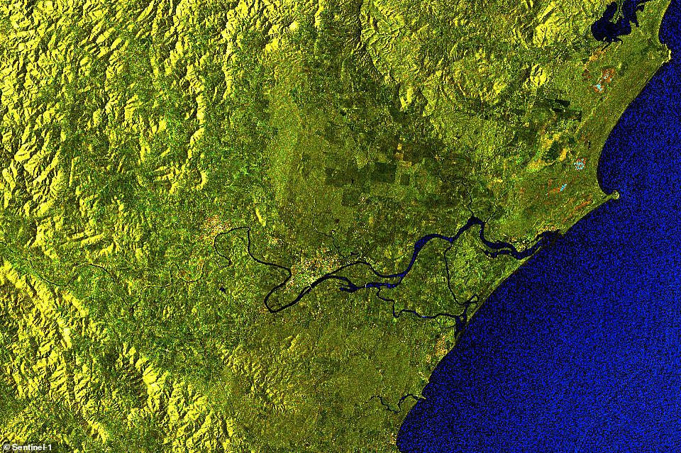 Incredible satellite images show the devastating caused by the floods. This shows the Manning River near Taree on the NSW mid-north coast before the storm