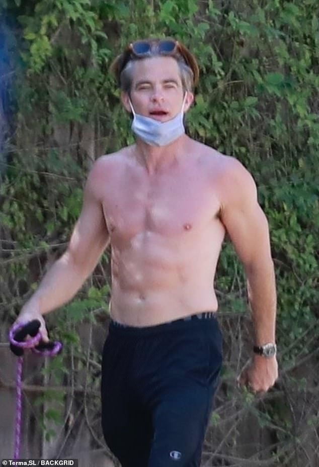 Adonis:u00A0Emmy nominee Chris Pine ditched his Miami Vice muscle tee to better showcase his six-pack abs and bulging biceps while walking his dog in Los Angeles on Sunday