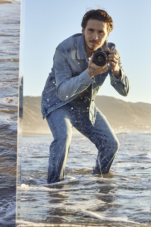 Making a splash! The eldest child of Victoria and David Beckham merges modelling and photography in the Pepe shoot, which sees him brandishing his camera and paddling in the ocean