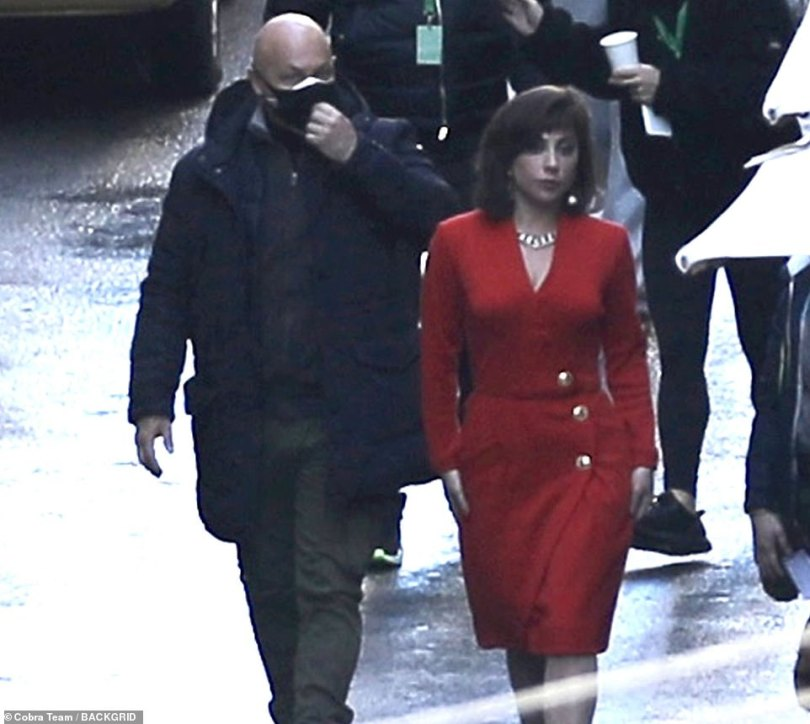 Side by side: The American star was accompanied by a bodyguard as she made her way across the Rome set on Monday