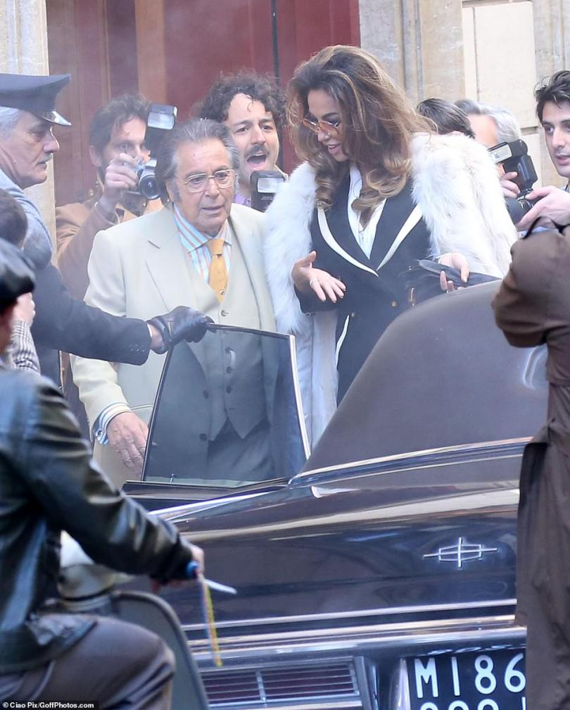 Let's go: Pacino and Ghenea were filmed hurrying into a waiting car as another scene got underway in the Italian capital on Monday