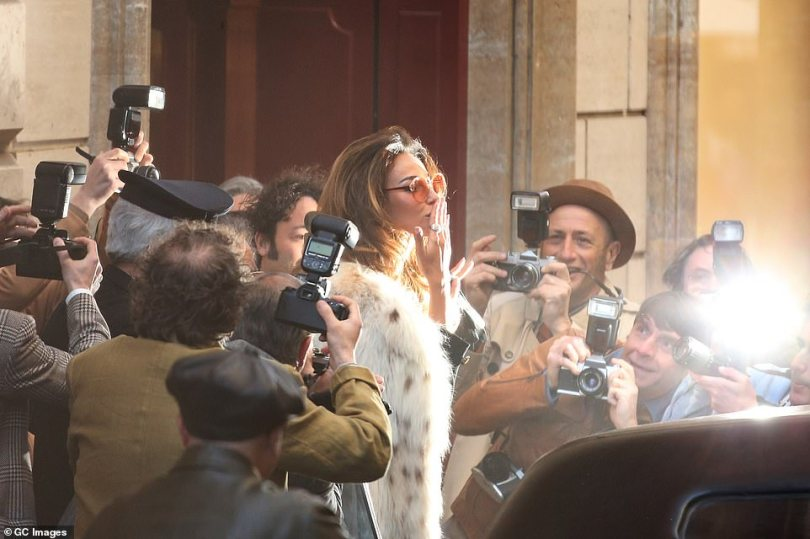Farewell:Ghenea was filmed blowing kisses to the crowd as she forced her way into her car