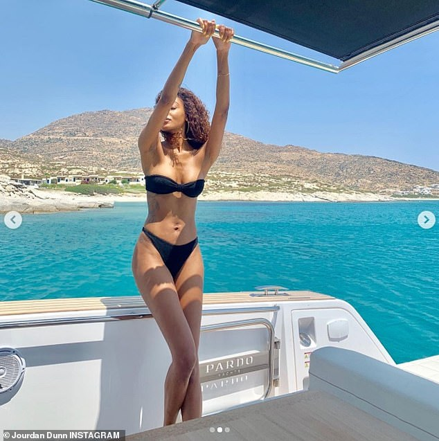 Sensational: Jourdan Dunn showed off her slender figure in a black two-piece on Monday as she sipped on alcohol from the comfort a luxurious yacht in a series of throwback photos