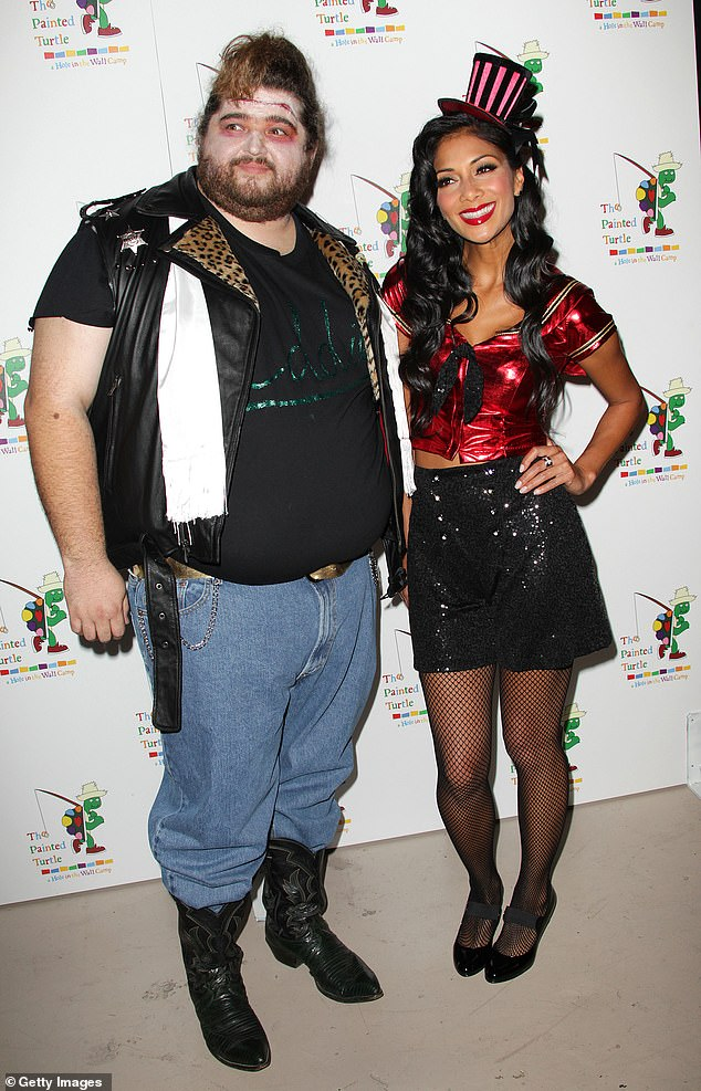 Party man: The actor wore a tight-fitting T-shirt and jeans as he posed with Nicole Scherzinger in 2010, for The Rocky Horror Picture Show tribute in LA