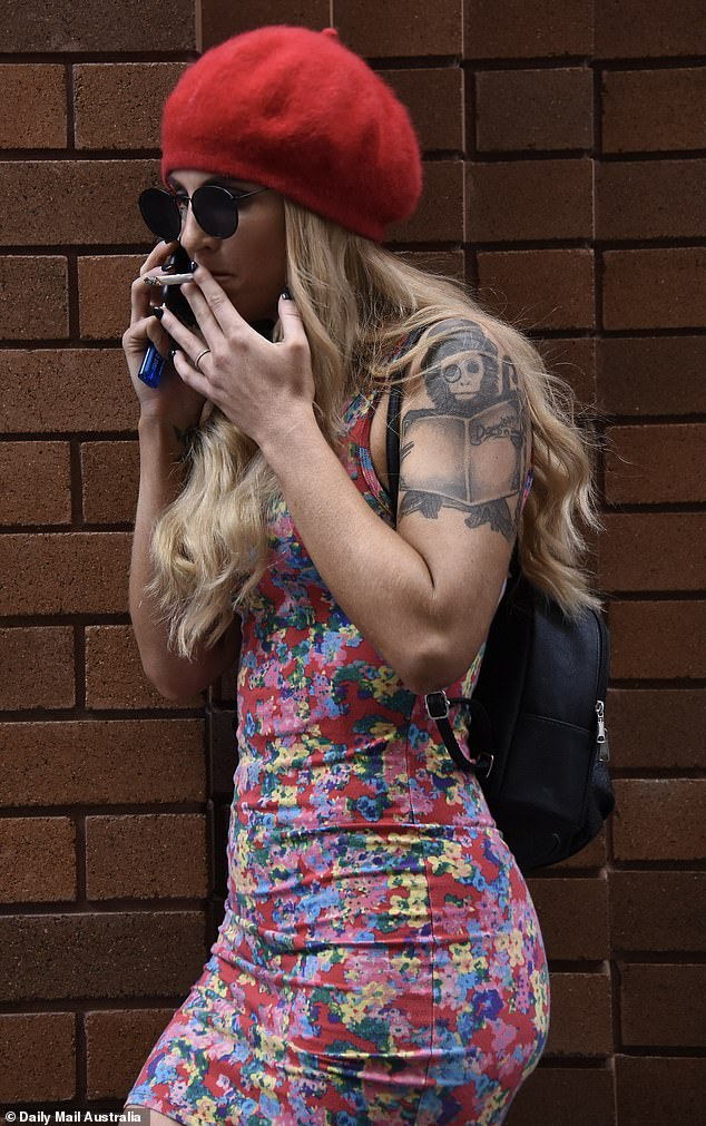 Stressed: According to an eyewitness, the Perth based singer was seen pacing up and down the street before she lit up a cigarette