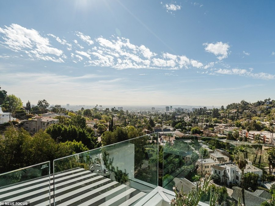 The property is situated on a small lot in a hillside setting and walls of glass offer stunning canyon and city views with the entire top floor presenting as a penthouse suite