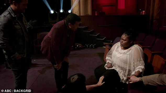 Tough time:With Funke rolled away, Lionel walked up to Ronda, who was now sitting in the bucket seats emotional over Funke's medical emergency