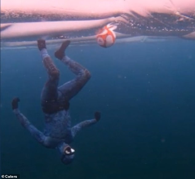 Andrew Ryzebol (pictured), 29, played the game with his friend Alex to see who could get the ball to the surface of Lake Huron in Ontario