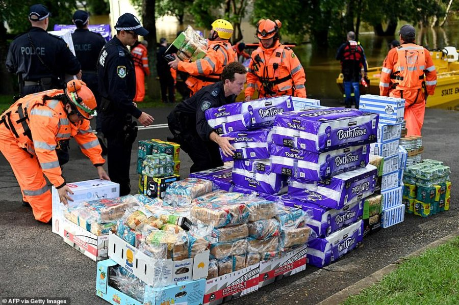 Members of the State Emergency Service prepare medical supplies and relief goods to take to flood-affected residents during rescue operations in Windsor in northwestern Sydney