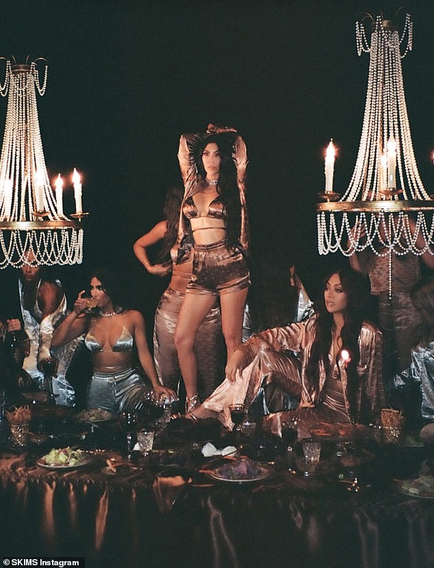 Night in: The Kardashian trio glowed in an array of smooth, shiny pieces in a range of nudes as they indulged in drinks and desserts under a crystal chandelier