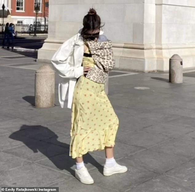 Good mommy:Emily Ratajkowski welcomed her first child just over two weeks ago. And on Tuesday the 29-year-old supermodel shared a first image on the town with her little one, Sylvester Apollo Bear. The bundle of joy was strapped to her front as she displayed a chic outfit