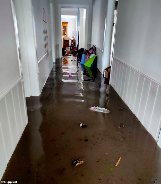 Within hours, the entire house and car had been virtually destroyed by floodwaters (pictured)