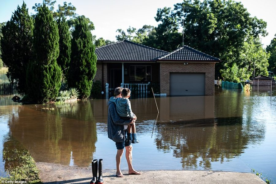 More than 10,000 requests for help have been made in NSW since last Thursday, with emergency services performing more than 900 flood rescues. Pictured: A flooded home in Londonderry, 60km north-west of Sydney