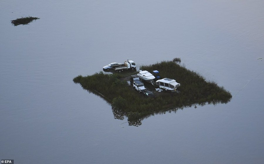 A confronting photo taken from a helicopter in Windsor, north-west of Sydney, on Wednesday morning highlights the flood crisis in New South Wales