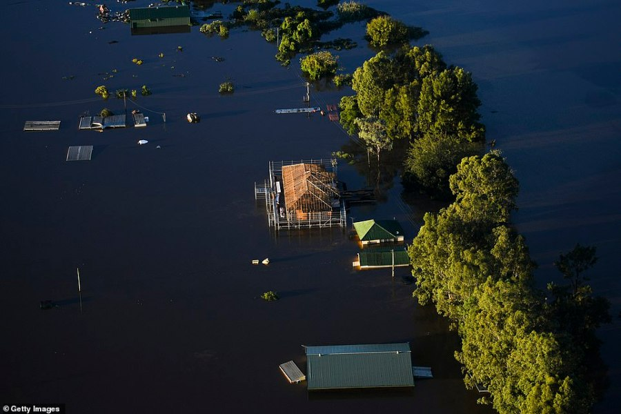 A home under construction is pictured partly submerged along the Hawkesbury River. Days of continuous rain have led to dozens of communities being declared disaster zones