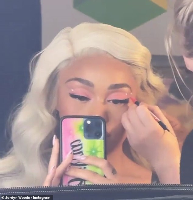 It's in the details: The reality star and social media personality had soft pink eye showdow to go along with her platinum blonde hair