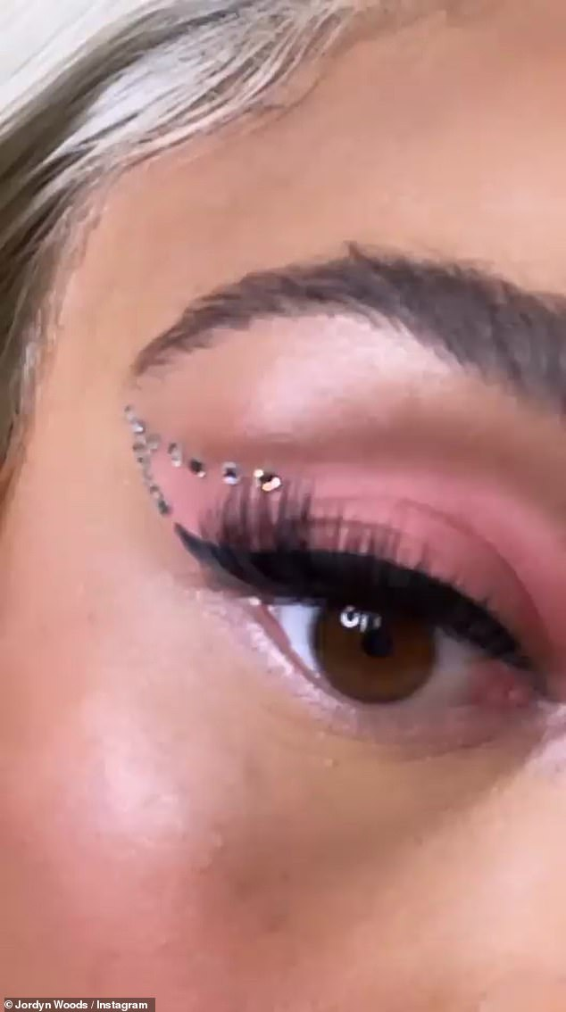 Added touch: There' also a clip that gives her 11.8 million Instagram fans and followers a closeup look of the face jewels placed near the corners of her eyebrows and eyelids.