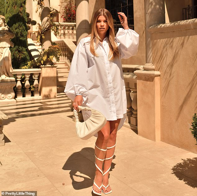 Hard to miss:Further images find Sofia drawing attention to her legs as she models a balloon sleeve shirt dress and killer heels