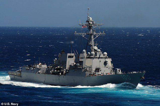 The USS Kidd, pictured above in 2011, was one of four Navy destroyers swarmed by sophisticated drones in 2019. An investigation has failed to uncover the origin of the drones
