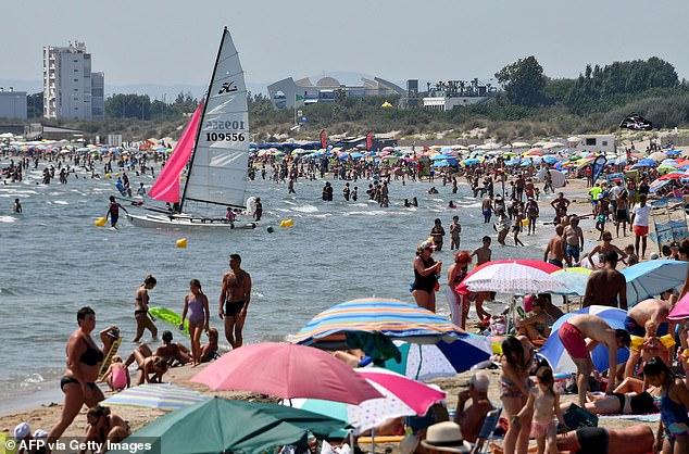Pictured: People enjoy the beach in La Grande-Motte on August 1, 2018