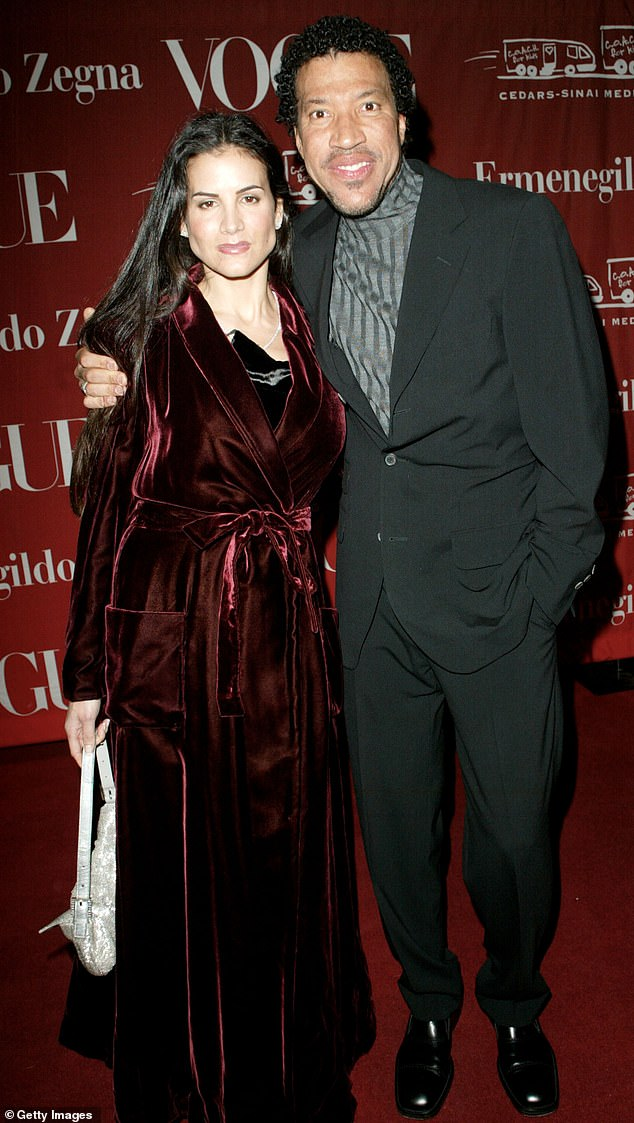 """""""Bring mom's dress to work,"""" the 22-year-old beauty said in a slideshow that caused a storm around Papa Lionel Richie's mansion in Beverly Hills.  Diane Alexander seen with ex-husband Lionel Richie in 2002"""