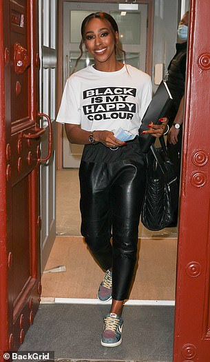 Accessories: She toted a large blackhandbag for the outing