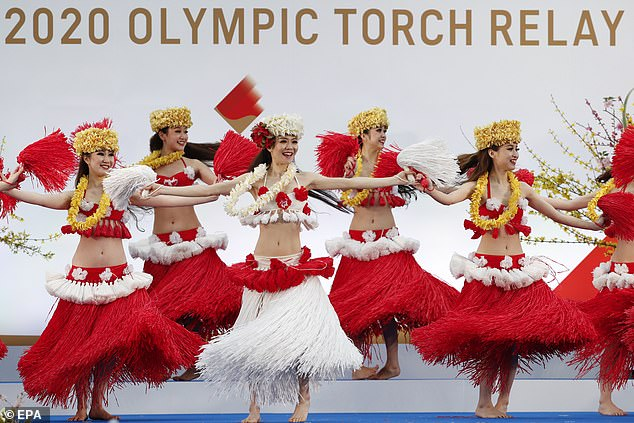 Members of the Spa Resort Hawaiians Dancing Team 'Hula Girls' perform during an opening performance on the first day of the Tokyo 2020 Olympic torch relay