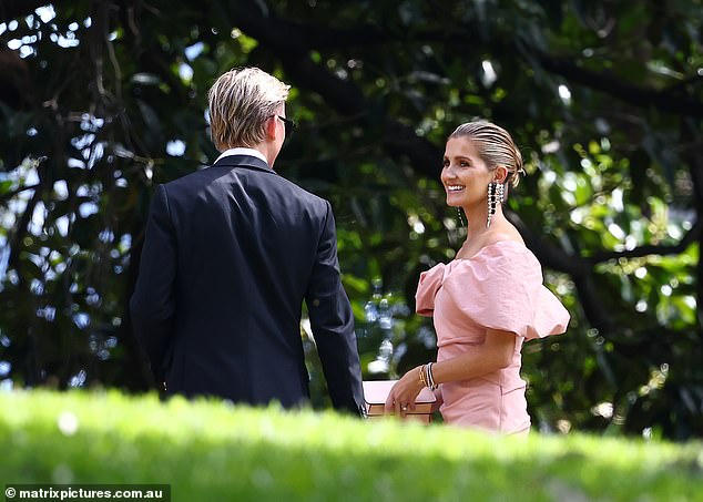Working the crowd: A smiling Kate was spotted chatting with a male guest as they stood outside at the wedding