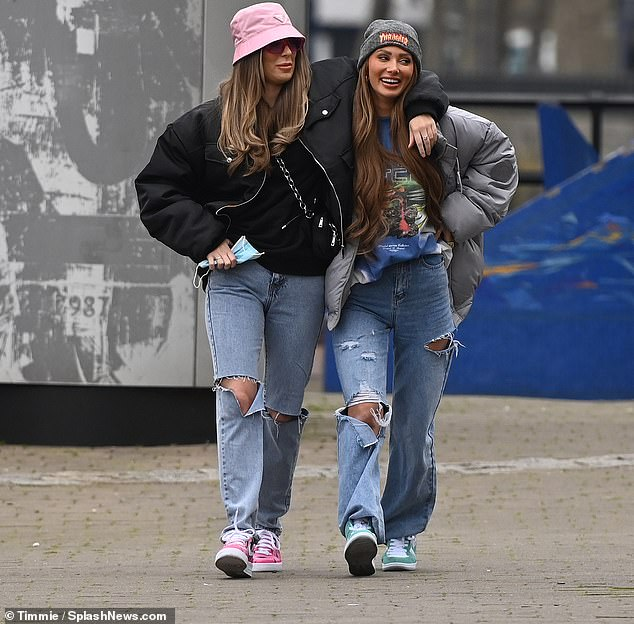 Unfazed: Demi Sims put on a loved-up display with her girlfriend Francesca Farago in East London on Wednesday after she was suspended from TOWIE for breaking lockdown rules