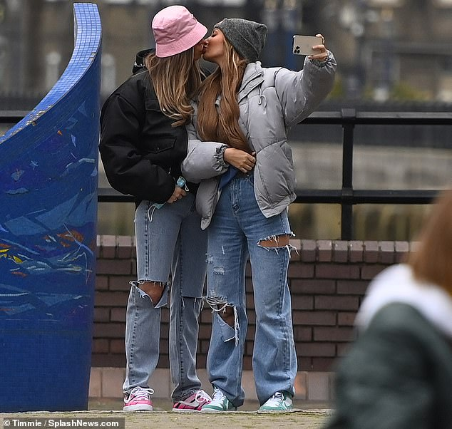 Love is in the air: The TOWIE star styled her blonde tresses in a loose wave and sported full coverage make-up as she shared a tender kiss with her girlfriend outdoors