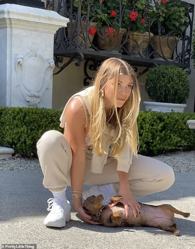 Here we go:Sofia is clearly in a relaxed mood as she lavishes pet dog Hershela with attention in unused images from her latest PrettyLittleThing campaign