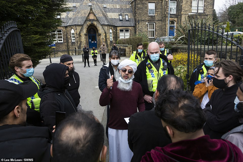 Mufti Mohammed Amin Pandor, a local Muslim scholar, speaks to the crowd gathered outside Batley Grammar School today