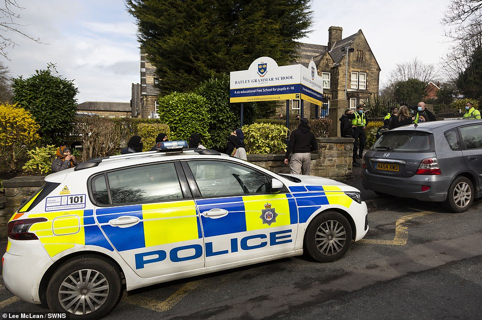 Police positioned outside the school gates amid the demonstrations taking place at Batley Grammar School this morning