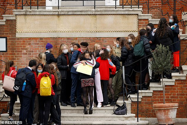 Boys and girls hugged each other outside the £22,000-a-year Highgate School in north London after claims emerged from current and former students