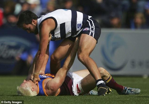 Geelong's James Bartel gives Akermanis a jumper punch in the 2006 AFL season opener