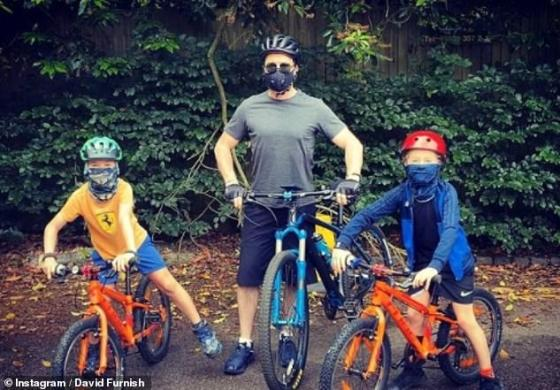 Challenges: The music icon, sharing sons Zachary, 10, and Elijah, eight, with husband David, admitted homeschooling is 'difficult' (pictured June 2020)