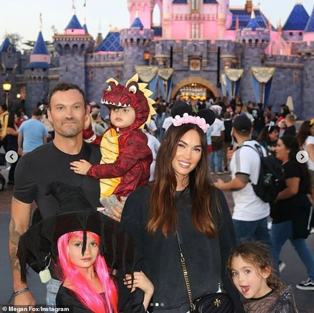 2019 family portrait: The Jennifer's Body alum indicated she separated from the father of her three sons - 90210 alum Brian Austin Green (L) - in November 2019 and officially filed for divorce from him on November 25