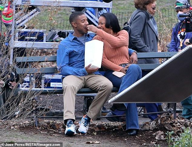 Snacks:Jordan was seen wearing a grey t-shirt under a blue denim work shirt as he got close with Adams