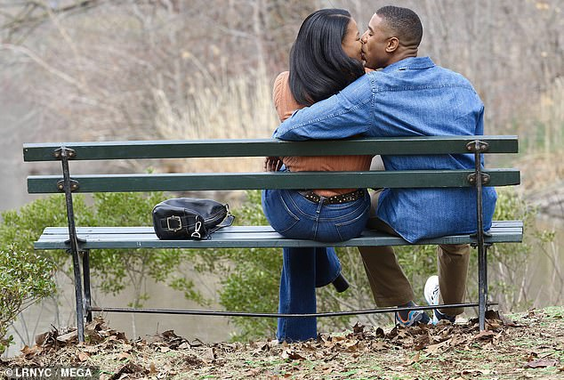 Kissing:Michael B. Jordan and co-star Chante Adams are all smiles as they share a kiss on the set of A Journal for Jordan