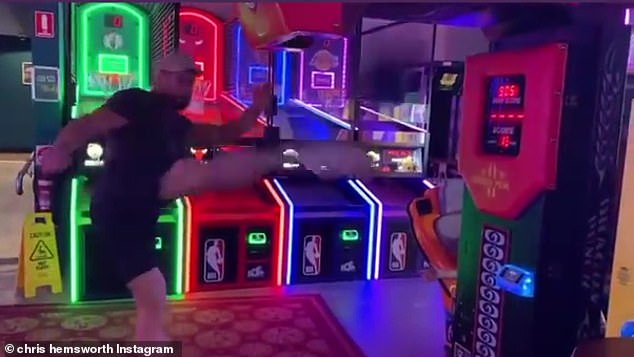 Kicking it up a notch: A second video showed Chris delivering a powerful roundhouse kick to the punching bag, which was level with his head