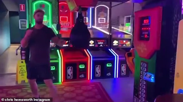 Greatest hits: The 37-year-old Thor actor was at an arcade with some friends, including stunt artist Bobby Holland Hanton, when he decided to try his hand at a boxing game