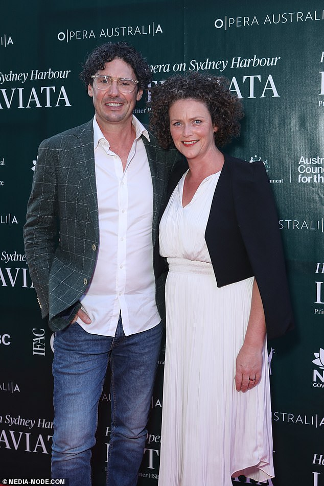 A fine pair:Colin Fassnidge, 45, dressed down for the occasion, with the My Kitchen Rules host choosing jeans and a blazer while his wife Jane Hyland opted for a pretty white dress with pleats and a bolero jacket. Both pictured