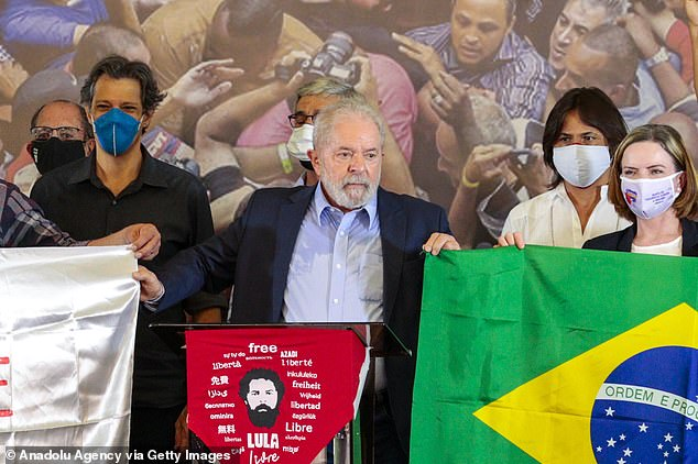 Brazil's former president Luiz Inacio Lula da Silva (pictured on March 10 after a corruption conviction against him was annulled) has launched a scathing attack on Brazil's current leader Jair Bolsonaro, saying Brazil's over 300,000 deaths from the coronavirus amount to the 'biggest genocide' in the Latin American country's history